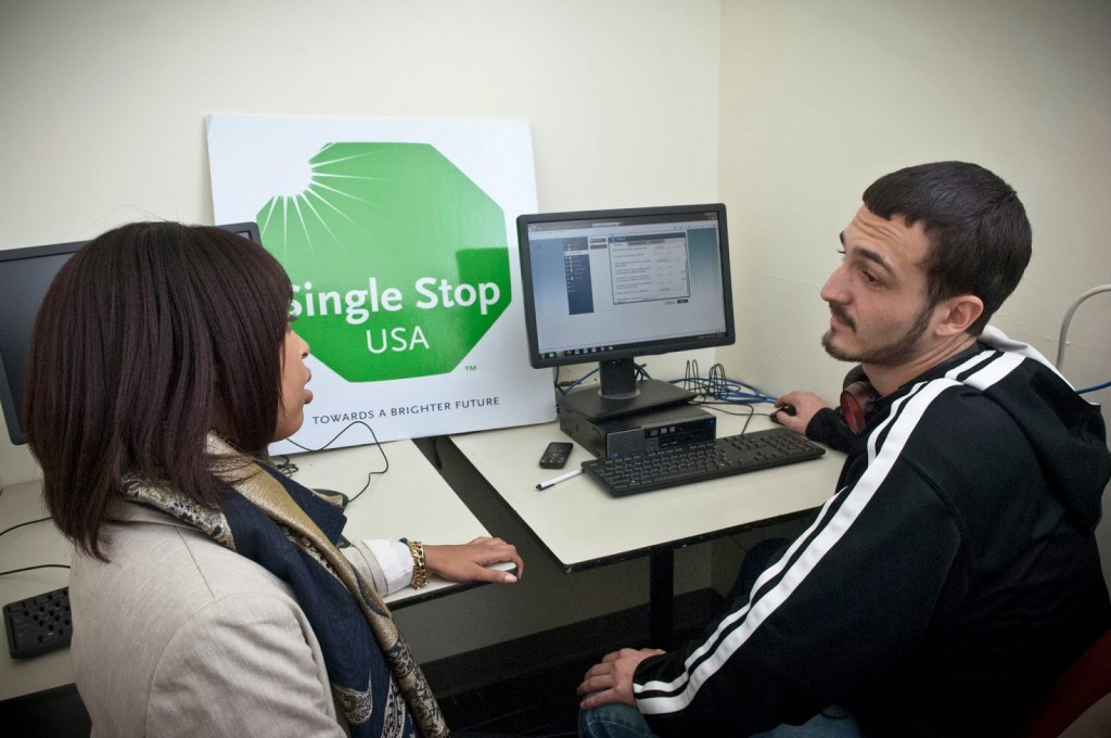 Chantal Whitehead, assistant project director at the Single Stop office at Community College of Philadelphia, talks with student Edward Busch about the service.